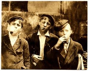 Lewis_Hine,_Newsies_smoking_at_Skeeter's_Branch,_St._Louis,_1910